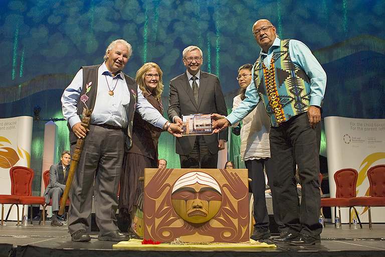Presenting UBC's expression of reconciliation with Justice Murray Sinclair, Chair of TRC; Dr Marie Wilson, TRC Commissioner; Stephen Toope, President of UBC; and Madeleine Basile and Eugene Arcand, both from The Indian Residential School Survivor Committee. Photo credit: Melissa Knapp