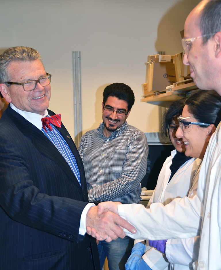 Randall Findlay meets students who work in the new lab. Photo credit: Patty Wellborn