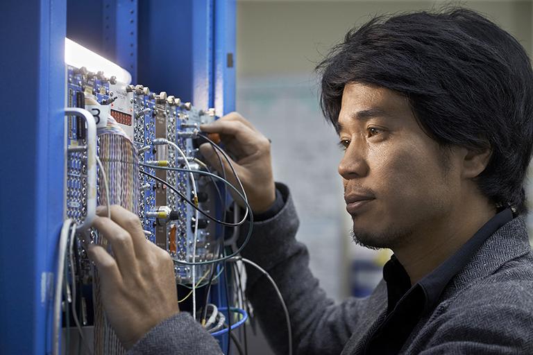 Makoto Fujiwara works on the ALPHA experiment. Photo credit: TRIUMF
