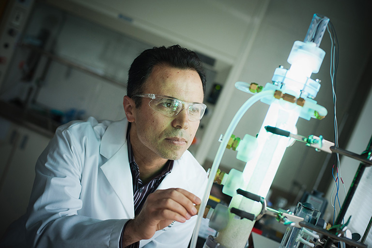 Dr. Madjid Mohseni works in his advanced oxidation research laboratory. Photo credit: Martin Dee