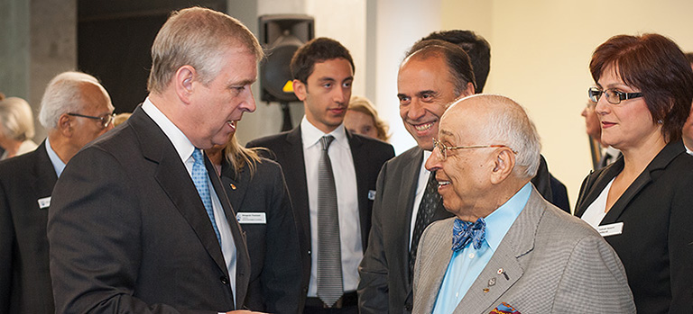 The Duke of York (left) speaks with Dr. Djavad Mowafaghian (right). Photo credit: Martin Dee